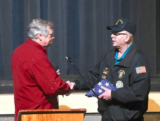 U.S. Senator Jeff Merkley presented J. W. Terry of Central Oregon Veterans Outreach with a flag flown over the U. S. Capitol in recognition of services provided by COVO to the veterans of Central Oregon at last week's town hall. photo by Jerry Baldock