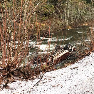 The construction manager for The Lodge at Sisters rescued a family from a wreck on Hwy. 22 last Wednesday. Their vehicle was in the North Santiam River. photo provided