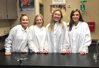 Sisters students Emma Farley, Amy Hills, Sydney Rawlins and McKenna Liddell are raising funds to attend a science event in Belgium. photo by Charlie Kanzig