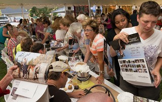 Quilt models signed hundreds of autographs at a party last week. photo by Gary Miller