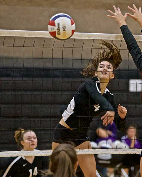 Sophie Silva goes up for one of 10 kills in a three-set loss to Sweet Home. photo by Jerry Baldock